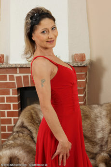 Elegant and petite Syndi Bell from AllOver30 posing in her sexy dress