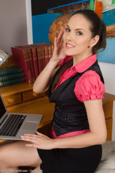 Beautiful brunette Tea from AllOver30 shows off her tits at her desk