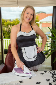 Elegant MILF Abi Toyne playing in her maid outfit in stockings and heels