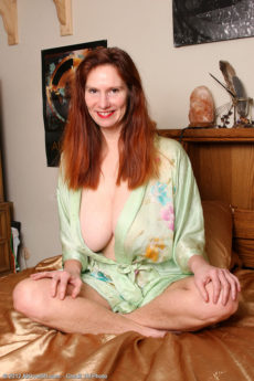 Horny redheaded Breeze from AllOver30 gets intimate with her dildo