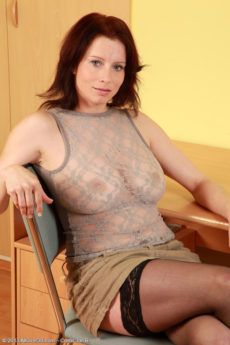 Beautiful curvy redhead Carol takes on her dildo in stockings