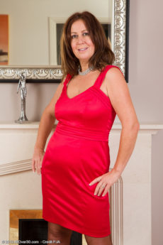 Elegant 47 year old Carol Foxwell slips out of her sily evening dress
