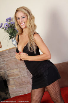 32 year old Cherie Deville in a elegant black dress strips on camera
