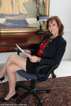 Horny office worker Lynn strips at her desk and plays with herself