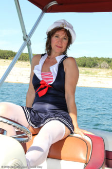 Over 50 beauty Lynn plays naked but for stockings on a boat