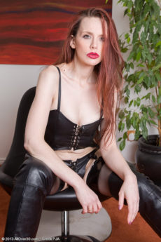 Hairy redhead MILF Mystique loves dressing up in leather and lingerie