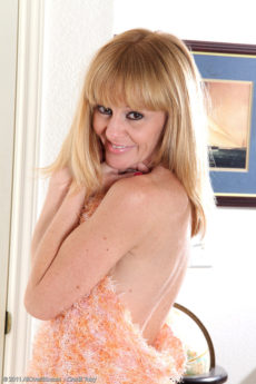Blonde 40 year old housewife Penelope slips off her sundress in here