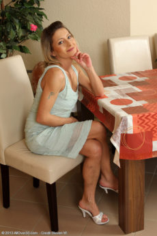Petite 45 year older Syndi Bell from AllOver30 spreading her lengthy legs