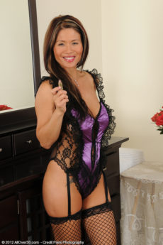 Exotic MILF Trisha spread her mature silky legs clad in black fishnets
