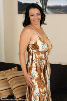 35 year old brunette MILF Leona Sweet is a busty hottie from all over 30 that will light your fire