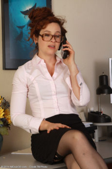 Sexy red haired secretary Fiona pulls up her skirt to show her furry pussy