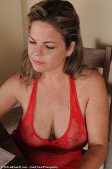 Curvy mom Marie Michaels in her red lingerie showing her huge boobs and wet twat