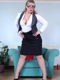 Sexy chubby secretary in glasses Danielle T undresses and fucks her sex toy to make you horny
