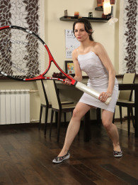Cute small tits MILF Candice plays with her tennis racket and spreads her pussy