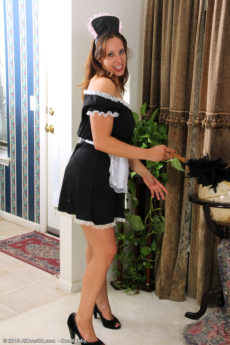 Gorgeous MILF maid Cassandra Johnson cleans up before getting nude - Horny maid Cassandra Johnson dusts and strips