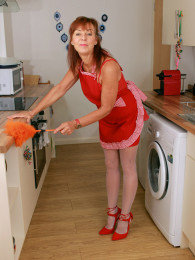 Horny housewife Georgie dressed up like a maid and fucking veggies in the kitchen