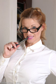 Smiling secretary MILF April Key looking hot in glasses and removing her skirt to show her pussy