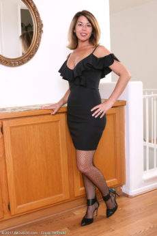 Gorgeous hot body MILF Niki is in stockings and steps out of her evening dress and opens her lovely pussy