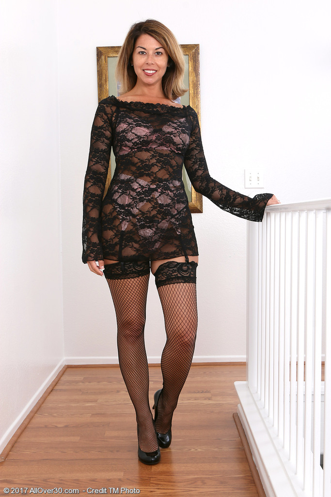 Stunning MILF Niki Strips Off Her Clothes and Poses In Her Stockings and Heels