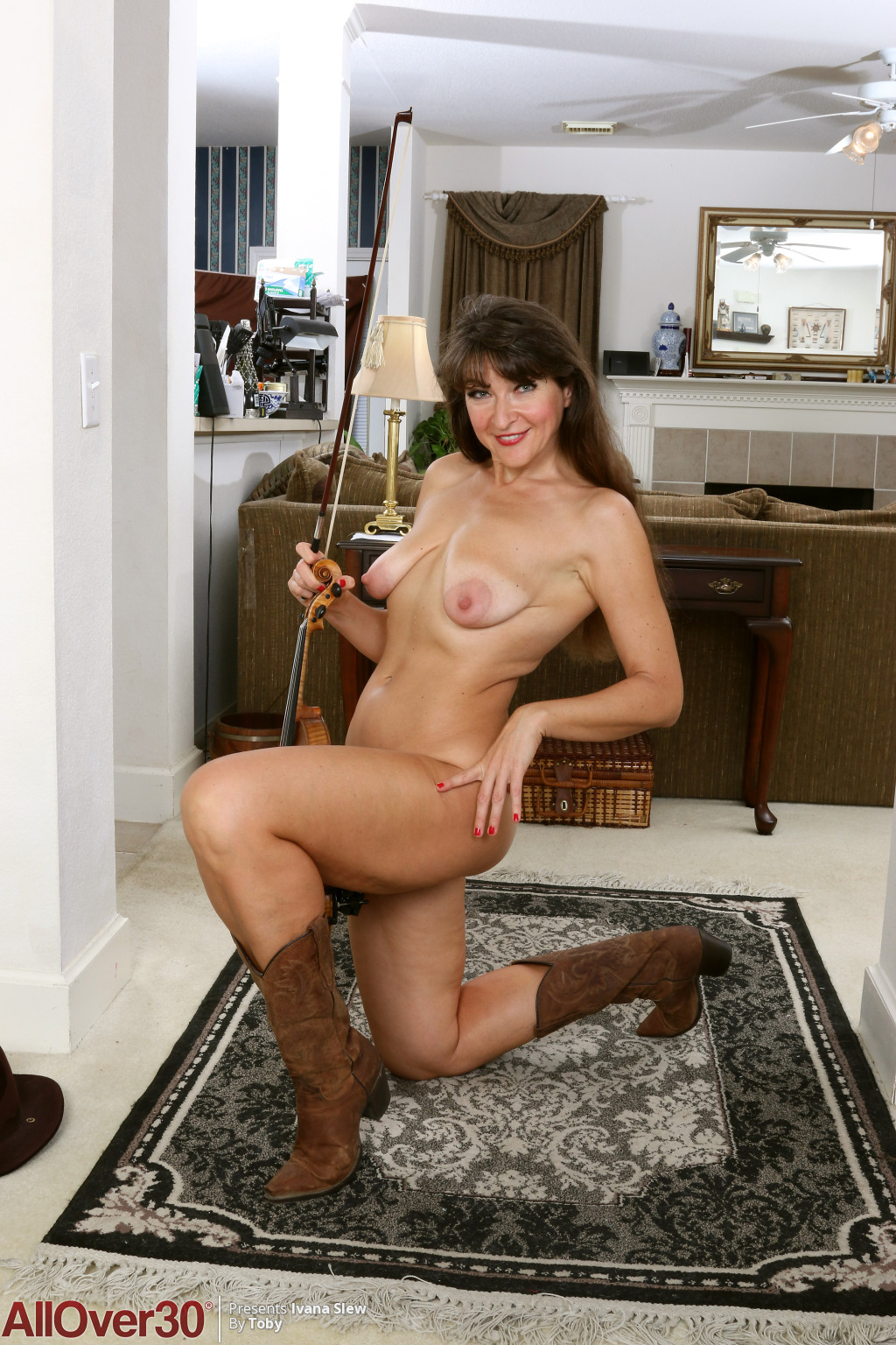 horny-cowgirl-ivana-slew-lets-us-see-her-saggy-breasts-and-hot-shaved-pussy12.jpg