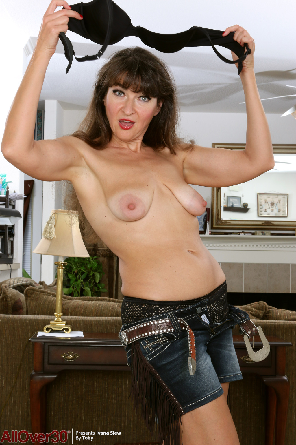 horny-cowgirl-ivana-slew-lets-us-see-her-saggy-breasts-and-hot-shaved-pussy8.jpg