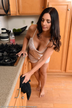 Hot busty MILF Mindi Mink takes off her clothes in the kitchen