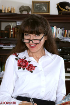 Sexy librarian Ivana Slew wearing glasses and getting nude to show off her saggy tits and hot pussy