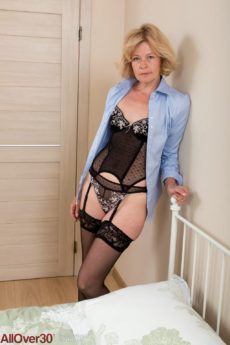 Sexy blonde grandma Diana V playing in her lingerie and stockings