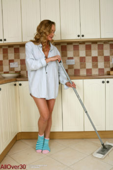 Gorgeous blonde over 40 babe Elegant Eve mopping the kitchen