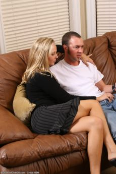 Experienced curvy blonde Lauren rides a younger hard cock on the sofa