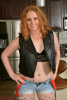 Sexy redhead housewife Roxy Normandy strips in the kitchen and bends over