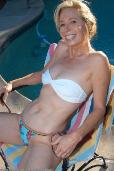 Smoking hot 54 year old Marie Kelly in the garden for a tan