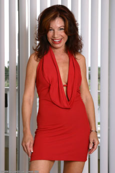Hot cuban MILF Jacqueline removes her tight red dress to pose naked
