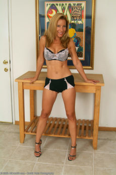 Tight skinny blonde MILF Rachel takes off her bra and panties and shows her hot tan bod