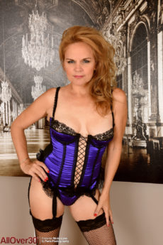 Mature strawberry blonde cutie Micky Lynn looking hot in her stockings and corset