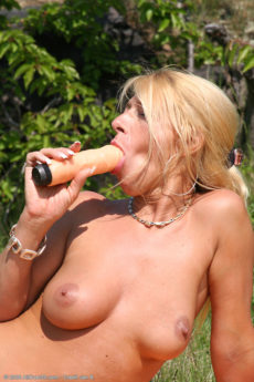 Horny blonde mom Sylvie rocks her pussy with a huge toy