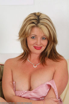 Busty Sherry V slips off her clothes and probes her pink mature pussy with her dildo