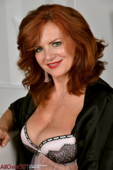 Curvy redhead Andi James is horny in her stockings