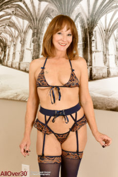 Hot MILF Cyndi Sinclair taking off her lingerie and stockings for you
