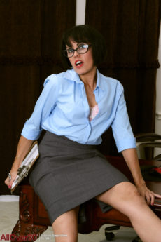 Secretary MILF Gypsy Vixen wearing glasses and stripping at her desk
