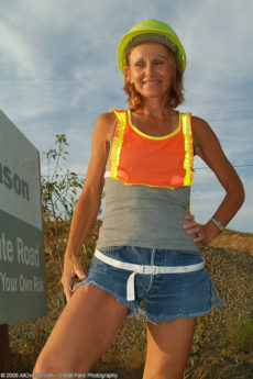 Petite MILF Kate spreads her legs outside with the construction tractors