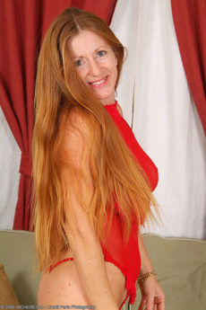 Redheaded housewife Wendy in red lingerie wowing with her body