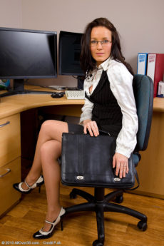 Beautiful Marlyn gets sexy in her office and spreads open her pussy