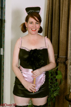 Fair skinned chubby MILF maid Caitlin Moore posing nude