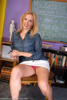 Horny blonde Katrina plays teacher and spreads her sexy legs