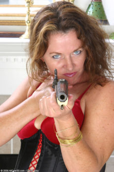 Intense looking MILF Sally is hard at work playing with her pussy