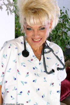Mature blonde nurse Michelle steps out of her uniform