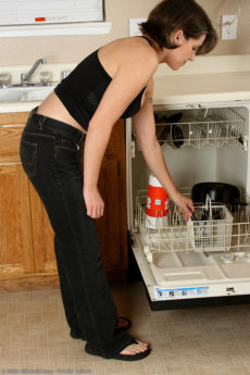 Short haired housewife Jocelyn strips while emptying the dishwasher