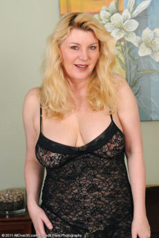 Busty 51 year old Venice posing in stockings and lingerie