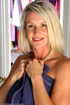Gorgeous 35 year old Ingrid puts lotion on her tan toned body